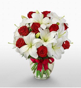 Aksaray hediye çiçek yolla  1 dal kazablanka 11 adet kırmızı gül vazosu